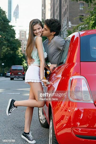 USA, New York, Young couple kissing on street