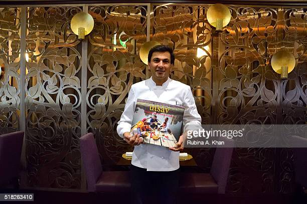New Yorkbased Indian Michelinstarred chef Vikas Khanna with his book Utsav A culinary epic of Indian festivals that he photographed across India for...
