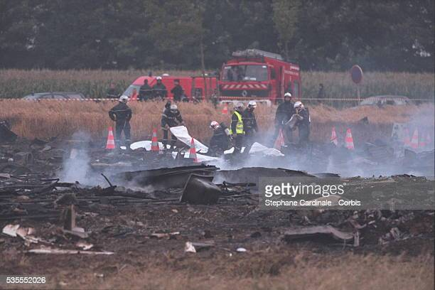 A New Yorkbound Air France Concorde crashed two minutes after taking off from Roissy Airport killing 113 In the photo firemen on the site of...