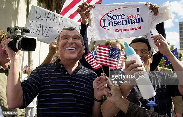 New Yorker Chuck Walker dressed as Republican presidential candidate George Bush cheers in front of the Stephen Clarke government Building in Miami...