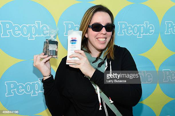 New Yorker enjoys smashbox and Vaseline gifts from PEOPLE's TWEET FOR TREATS vending machine at Columbus Circle on October 8 2014 in New York City