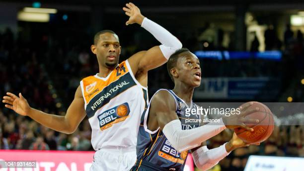 New Yorker Phantoms Braunschweig's player Dennis Schroeder vies for the ball with sOliver Baskets' player Dwayne Anderson during the Day of the...