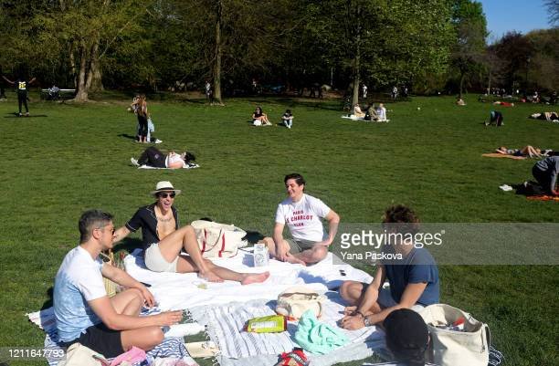 New Yorkers congregate in Prospect Park during nice weekend weather as social distancing guidelines remain in place to limit the spread of...