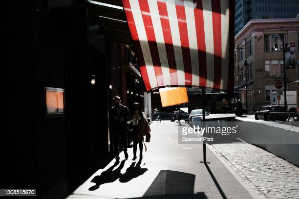 New Yorkers enjoy a warm spring afternoon on March 22, 2021 in New York City. As the city slowly moves out of quarantine from the COVID-19...