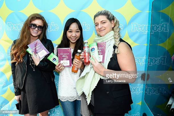 New Yorkers enjoy fruitwater and Vaseline gifts from PEOPLE's TWEET FOR TREATS vending machine at Columbus Circle on October 8 2014 in New York City