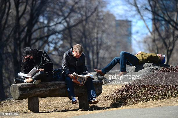 New Yorkers enjoy the sun in Central Park on March 15 2014 in Manhattan New York USA