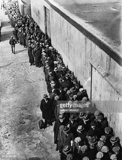 New Yorkers queue at a soup kitchen set up by Mayor La Guardia in response to a recent cold snap ca 1935