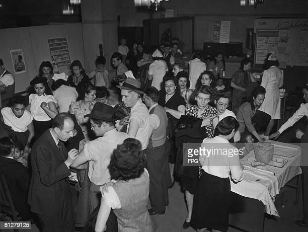 New Yorkers receive free smallpox vaccinations after twelve cases were reported in the state, April 1947.