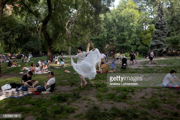New Yorkers relax on the lawn of Tompkins Square Park on June 25, 2021 in New York City. With vaccination levels high and a low infection rate of the...