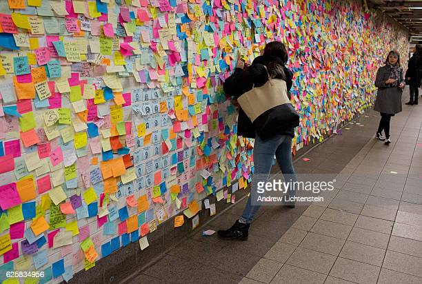 New Yorkers shocked and angered by the unexpected election of Donald Trump as President leave messages on colored note paper on the wall of the Union...