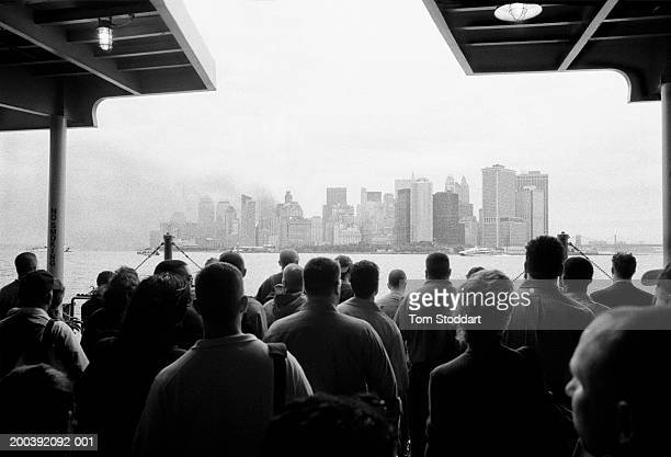 New Yorkers stand motionless and silent onboard the first Staten Island ferry to approach Manhattan after the 9/11 World Trade Centre attack, 17th...