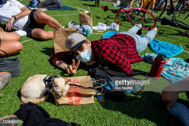 New Yorkers wear face masks and protective gear during the coronavirus pandemic at Domino Park in Williamsburg, Brooklyn on May 17, 2020 in New York...