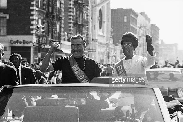 Harlem Congressman Adam Clayton Powell Jr and Congresswoman Shirley Chisolm of Brooklyn give the clenched fist Black Power salute during a parade in...