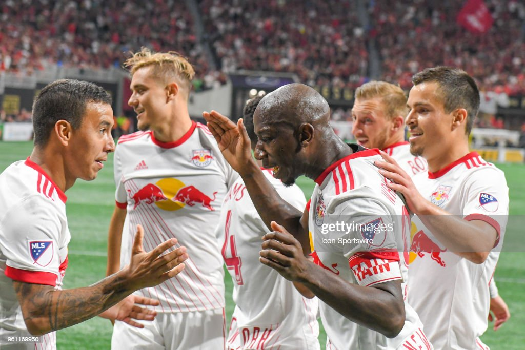 New York's Bradley Wright-Phillips (99) is surrounded by teammates after scoring a goal during the match between Atlanta United and New York Red Bulls on May 20, 2018 at Mercedes-Benz Stadium in Atlanta, GA. The New York Red Bulls defeated Atlanta United FC