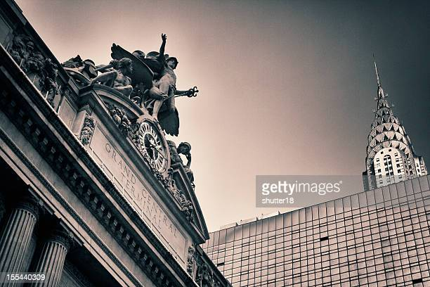 new york's grand central station next to chrysler building - grand central station stock photos and pictures