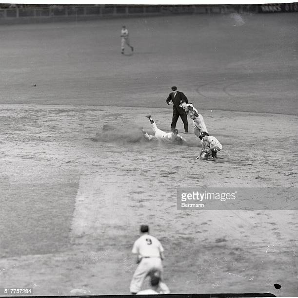 New York's Mickey Mantle is forced at second as ST Louis shortstop Demaestri fires to first in unsuccessful attempt to nip Yank Joe Collins in 6th...