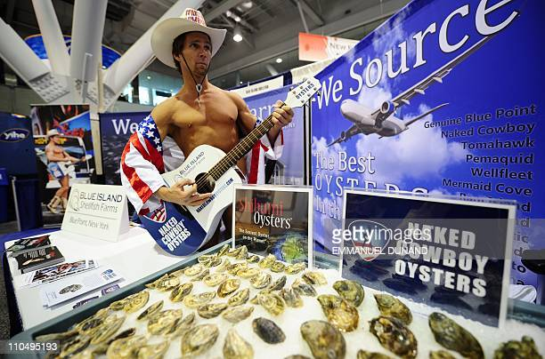New York's Times Square 'Naked Cowboy' advertises oysters during the 2011 International Boston Seafood Show look at the Boston Convention and...