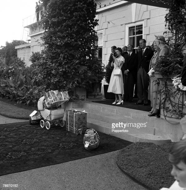 New Zealand 24th December Queen Elizabeth II using her cine camera at Government House watched by Prince Philip Duke of Edinburgh to film Santa Claus...