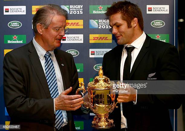 New Zealand All Black captain Richie McCaw hands the William Webb Ellis trophy over to to IRB Chairman Bernard Lapasset at Aviva Stadium on November...