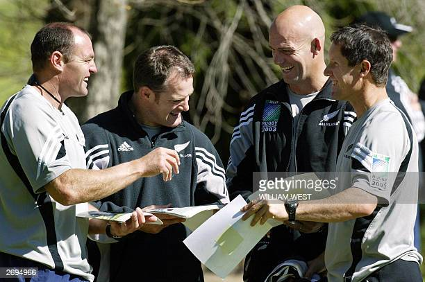 New Zealand All Black coach John Mitchell and assistant coach Robbie Deans share a joke with fellow coaching staff Daryl Halligan and Ross Neesdale...