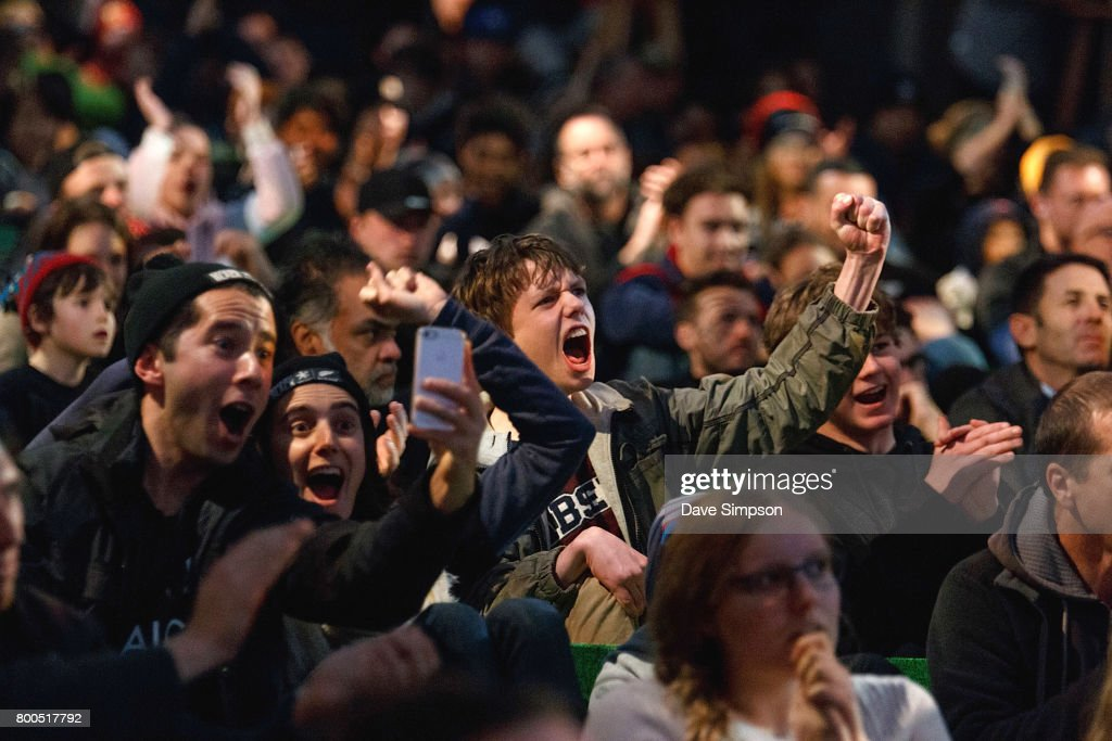 New Zealand All Black fans at the Queens Wharf Auckland Fan Zone watch the Rugby Test match between the New Zealand All Blacks and the British & Irish Lions on June 24, 2017 in Auckland, New Zealand.
