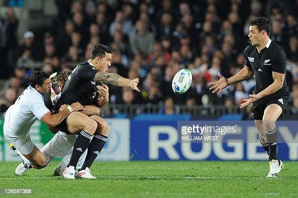 New Zealand All Black flyhalf Daniel Carter recieves the ball from New Zealand All Black Sonny Bill Williams during the 2011 Rugby World Cup pool A...