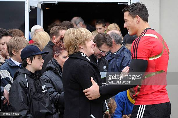 New Zealand All Black player Sonny Bill Williams and the team meet with families of those who lost loved ones in the February 22 earthquake after a...