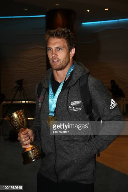 New Zealand All Black Sevens cocaptain Scott Curry holds the Melrose Cup after arriving back from the Sevens WOrld Cup in San Francisco at Auckland...