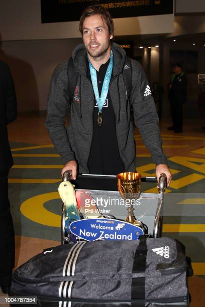 New Zealand All Black Sevens cocaptain Tim Mikkelson with the Melrose Cup after arriving back from the Sevens World Cup in San Francisco at Auckland...