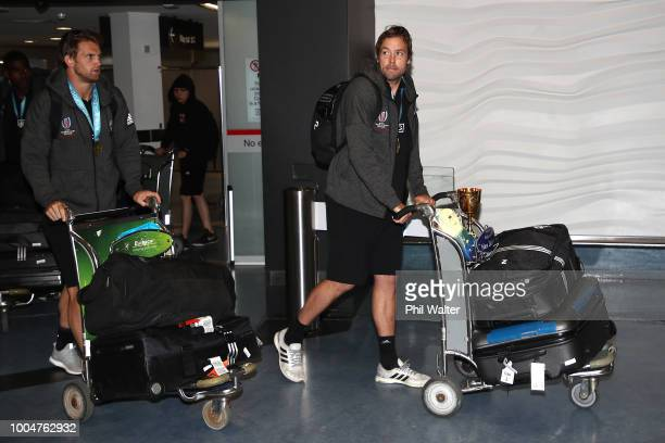 New Zealand All Black Sevens cocaptains Scott Curry and Tim Mikkelson arrive back from the Rugby Sevens World Cup in San Francisco at Auckland...