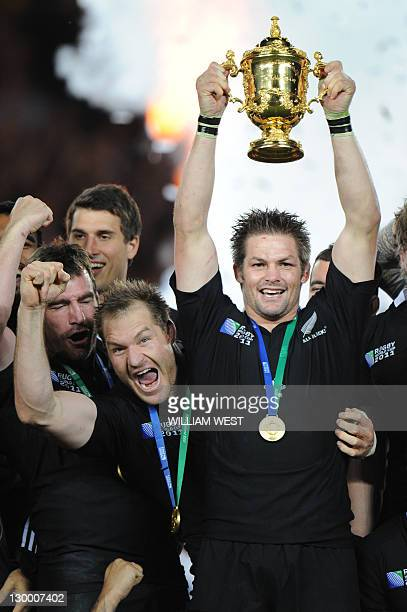 New Zealand All Blacks captain Richie McCaw holds the Webb Ellis cup after the 2011 Rugby World Cup final match New Zealand vs France at Eden Park...