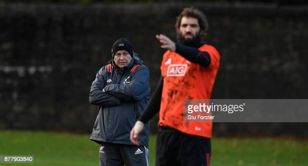 New Zealand All Blacks coach Steve Hansen oversees training as Samuel Whitelock makes a point prior to Saturday's International against Wales at...