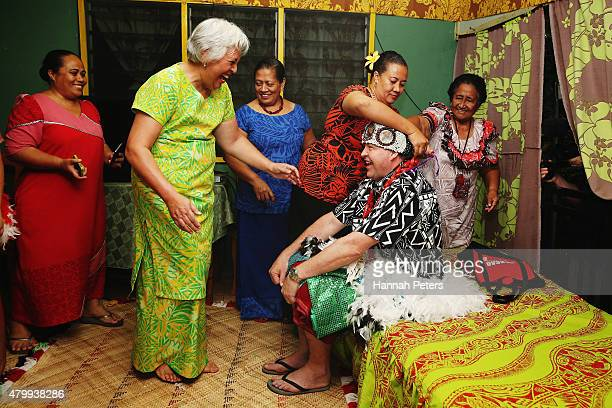 New Zealand All Blacks Head Coach Steve Hansen is dressed by women of Vaiala village prior to a ceremony making him a Honorary High Chief Of Vaiala...