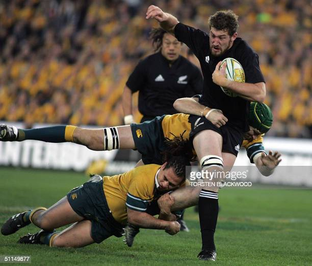 New Zealand All Blacks lock Chris Jack is tackled by the Wallaby defence during the Bledisloe Cup Tri-nations rugby union Test at Telstra Stadium in...