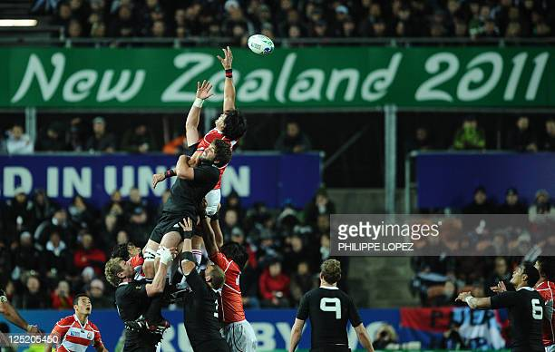 New Zealand All Blacks lock Sam Whitelock and Japan's lock Toshizumi Kitagawa jump for the ball in a lineout during the 2011 Rugby World Cup pool A...