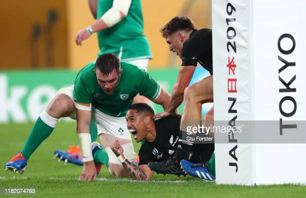 New Zealand All Blacks player Aaron Smith celebrates his first try as Peter O' Mahony of Ireland looks on during the Rugby World Cup 2019 Quarter...