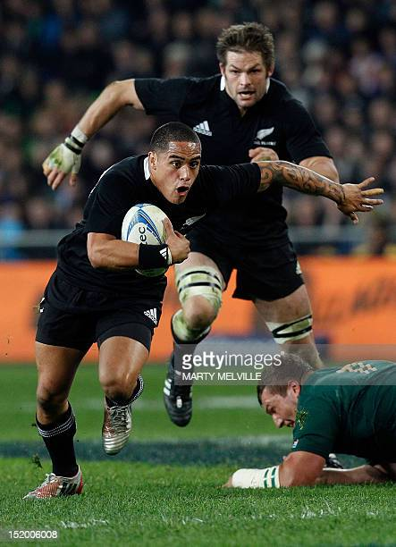 New Zealand All Blacks player Aaron Smith runs with the ball during a rugby union test match between New Zealand and South Africa at the Forsyth Barr...