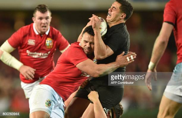 New Zealand All Blacks player Anton Lienert-Brown is tackled by British and Irish Lions players Ben Te'o and Peter O'Mahony during their Test match...