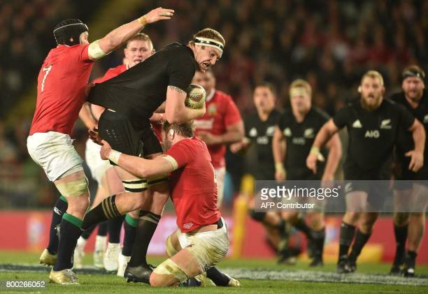 New Zealand All Blacks player Brodie Retallick is tackled by British and Irish Lions player Alun Wyn Jones and Sean O'Brien during their Test match...