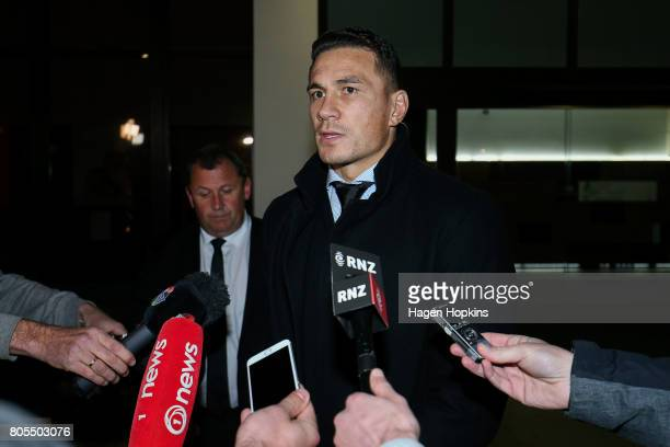 New Zealand All Blacks player Sonny Bill Williams speaks to media while assistant coach Ian Foster looks on after a judicial hearing at the New...