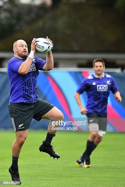 New Zealand All Blacks' prop Ben Franks catches the ball during a training session at the Lensbury Hotel in Teddington southwest London on September...