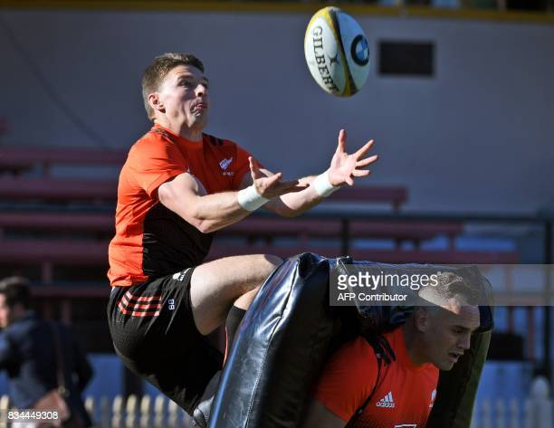 New Zealand All Blacks rugby player Beauden Barrett leaps over teammate Israel Dagg to catch the ball during their Captain's Run in Sydney on August...