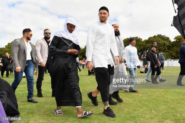 New Zealand All Blacks rugby player Sonny Bill Williams greets members of the public after attending islamic prayers in Hagley Park near Al Noor...