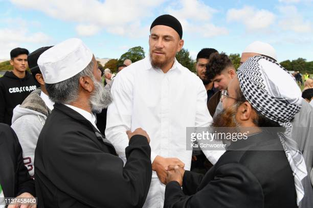 New Zealand All Blacks rugby player Sonny Bill Williams greets members of the Muslim community after attending islamic prayers in Hagley Park near Al...