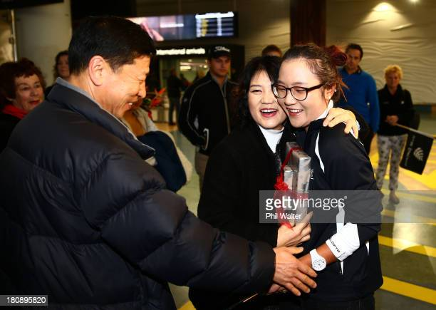 New Zealand amateur golfer Lydia Ko is welcomed home by friends and family upon her arrival at Auckland International Airport on September 18 2013 in...