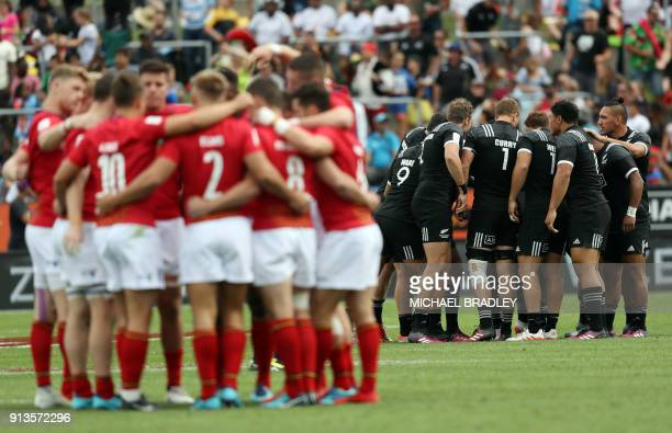 New Zealand and Scotland players await the start of the World Rugby Sevens Series match between Scotland and New Zealand at Waikato Stadium in...