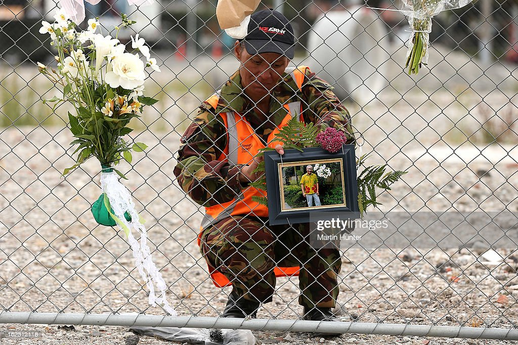 A New Zealand Army soldier places a picture on the CTV Building site during the memorial service marking the second anniversary of the Christchurch Earthquakes on February 22, 2013 in Christchurch, New Zealand. On February 22, 2011, a 6.3 magnitude earthquake hit Christchurch which, along with several aftershocks, killed 185 people.