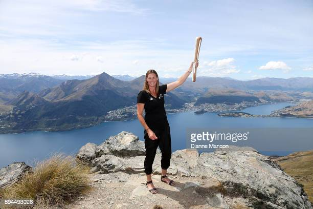 New Zealand athlete Donna Wilkins poses for a photo with the Commonweath Queen's baton at Cecil Peak during the Commonweath Games baton relay on...
