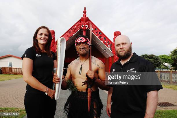 New Zealand athletes Holly Robinson and Ritchie Patterson stand with a Maori warrior and the Commonwealth Games Queen's baton during the Commonwealth...
