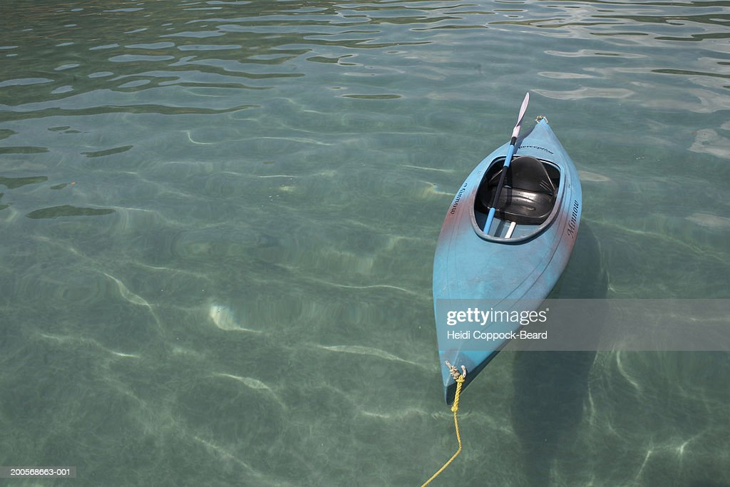 New Zealand, Auckland, Waiheke Island, Canoe moored in ocean : Stock Photo